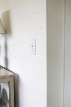 Side view of shiplap paneling, corner piece - The Inspired Room. This post answers FAQ on installing DIY shiplap walls. What wood or MDF to use for shiplap and what to do with the corner edges after install.