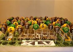 Superbowl Cake Pops - Have you thought about a Superbowl party? February 3 is fast approaching! Call us for ideas for a football feast.