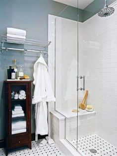 But with wood floor, basketweave floor in shower, subway tile: