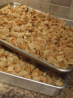 Christmas Crack Chex Mix: 1 12.8-ounce box Rice Chex cereal,  1 12-ponce box Golden Grahams cereal,  1 7-ounce bag shredded coconut,  1 4-ounce bag slivered almonds,  1 1/2 cups butter (3 sticks of butter),  2 cups sugar, 2 cups corn syrup