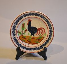 Small Llanelly pottery cockerel plate Boldly painted cockerel with sponge decorated border,  South Wales Pottery, Llanelly, Carmarthenshire c1900  6¾″ diameter  £550  Sarah Roberts or Auntie Sal as she was known worked at the Llanelly Pottery for over forty years and is chiefly associated with the decoration of these iconic Welsh plates.