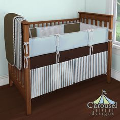 Crib bedding in Blue and Brown Ribbon Stripe, Solid Chocolate Minky, Cloud Gray and White Houndstooth, Chocolate Brown Organic, Solid Robin's Egg Blue. Created using the Nursery Designer® by Carousel Designs where you mix and match from hundreds of fabrics to create your own unique baby bedding. #carouseldesigns