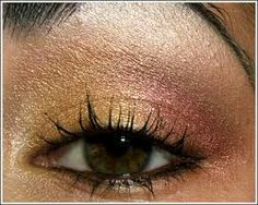 Gold and copper eye shadow.
