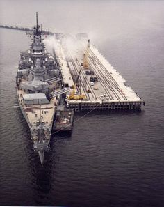 Wisconsin (BB-64) berthed at Pier 4 East of the Leonardo Pier Complex at the Naval Weapons Station, Earle, NJ, during 10-13 March 1990 to onload ammunition.