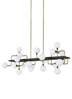 The Viaggio Linear Suspension by Tech Lighting features an artistic cluster of glass orbs for a sense of celestial travel within a room. Your choice of two gorgeous finish options include a sleek black body contrasted against solid Brass arms with white glass globes or polished nickel arms with mirrored smoke glass globes, either option will create a comfortable glare-free wash of illumination onto surfaces below. The Viaggio Linear is ideal for dining room lighting, living room lighting and…