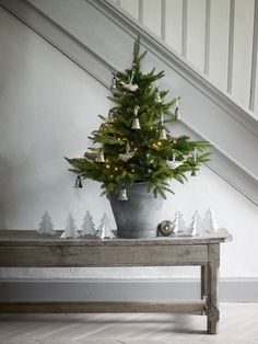 love the galvanized bucket and simple decorations for this small tree