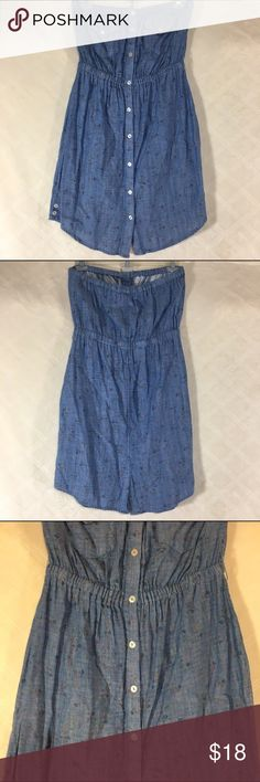 Strapless button down dress Strapless button down dress. Flower details inside is stripes. Two button pockets. Cute button details at the side on the bottom. Gathered waist. Charlotte Russe size small. 100% cotton. Charlotte Russe Dresses Strapless