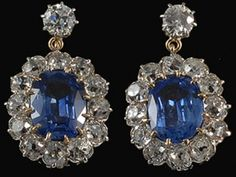 Victorian Ceylon Cornflower Blue Sapphire and Diamond Earrings, Stunning pair of earrings that truly capture the romance of the Victorian period. These gold earrings feature a cluster of diamonds surrounding a large natural ceylon cornflower blue sapphire.