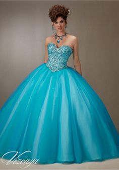 Quinceanera dresses by Vizcaya Layered Tulle Ball Gown with Embroidery and Jeweled Beading Matching Bolero Jacket.Colors: Pink Champagne, Island Blue.
