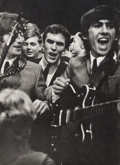 John Lennon, Neil Aspinall and George Harrison, and the Dutch audience crowding around them during their appearance on VARA-TV, the Netherlands, 5 June 1964 Photo: The Beatles Book