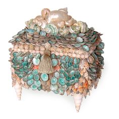 Unimaginably beautiful...the Aqua Limpet Chest is part of a unique collection of meticulously crafted boxes designed by one of the world's most talented shell artisans, Marjorie Bloom.