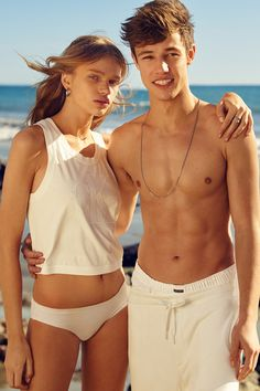 Sun, sand, skin: Stella Lucia in the cropped muscle tee and Cameron Dallas in the retro track shorts from the Spring 2016 Calvin Klein Jeans Limited Edition capsule. #mycalvins