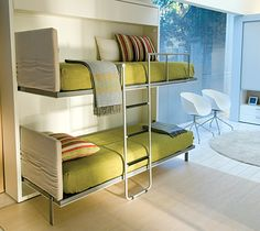 The Lollipop IN Space Saving System features a wall bunk bed system and a built in shelf.