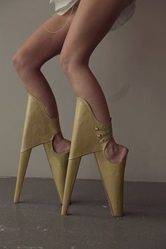 South African artist Leanie van der Vyver and Dutch created these treacherously high, backwards heels as a commentary on the great lengths women will go to for vanity. They're the most frightening footwear we've ever seen. Unsurprisingly, Lady Gaga has already borrowed them.