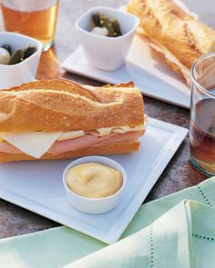 Ham and Swiss Sandwich | Martha Stewart Living - A classic ham and Swiss tastes even better served on a buttered baguette.