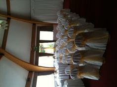 white linen covers with gold organza