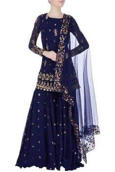 Buy Navy blue embellished sharara pant set by Astha Narang at Aza Fashions A navy blue short kurta accentuated with sequin embroidered motifs. It is teamed with a pair of matching sharara pants and comes with a dupatta. Indian Gowns Dresses, Pakistani Bridal Dresses, Pakistani Dress Design, Pakistani Outfits, Wedding Sarees, Sharara Designs, Kurti Designs Party Wear, Dress Designs, Blouse Designs