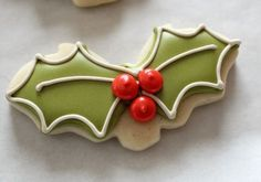 Reuse your Halloween bat shaped cookie cutters to make holly cookies for the holidays.