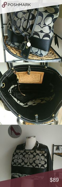 Coach med to large size shoulder bag or tote Pre loved as shown on bottom. A few pen marks inside. Has hang tags. Has gold lock to close bag. Handles in beautiful condition. No tears inside only corners on bottom show wear. Lots of life in this bag. Comes with dust cover. A few marks on outside canvas could be cleaned. Leather trim with gold accents. Coach Bags