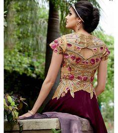 Fascinating Wine Heavy Anarkali Suit