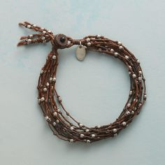 "TWIGLETS BRACELET -- Like supple young twigs budding with Thai silver beads, waxed cord wreathes the wrist. Bracelet features coconut shell button clasp. Handmade Sundance exclusive. 7-1/4""L."