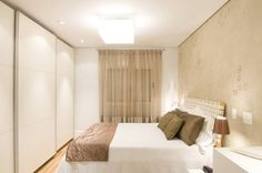 Camera da letto in stile translation missing: it.style.camera-da-letto.moderno di Liliana Zenaro Interiores