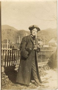 Antique real photo postcard of young woman in TROUSERS! in Montana, circa 1910.