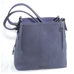 ⚡️SALE⚡️ Calvin Klein Navy Leather Shoulder Bag Stunning bag! Sold out and extremely rare, I wasn't able to find another one of these online or anywhere else. Structured thick yet very soft to the touch- navy leather with gunmetal hardware. Wide double handles with CK charm and 3 separate compartments inside with ID slot and card slots. New without tags & no dust bag. Trade value $200 -PRICED TO SELL. Calvin Klein Bags Shoulder Bags