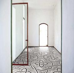 Black and white graphic tiles bring street art to the interior setting.