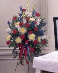 Flowers of patriotic colors would be a perfect way to pay tribute to your loved one in the service. (ES-6)