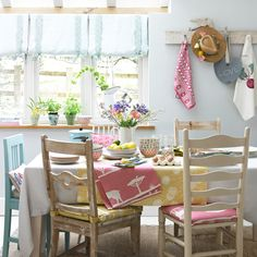 Weathered wood with pastel pinks, blues, and yellows makes for a lovely spring decorated dining room.