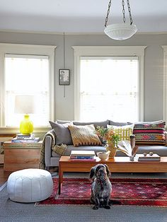 I can really see myself in this room too but a round table. Living Room Gray walls, cream trim like everything except the coffee table