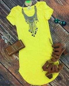 Yellow short dress, brown flip flops