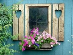 white on white cottage exterior with shutters | Gmomma Gmomma Pink flowers and shutters with heart