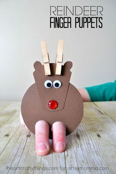 How to make the cutest EVER Reindeer Finger Puppet Craft out of everyday house objects for preschoolers. Great Christmas play craft.