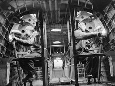 Two gunners in Short Sunderland Mark I, N9027, of No 210 Squadron RAF based at Oban, Argyll, sit at their positions with .303 Vickers K-type machine guns, mounted in the upper fuselage hatches.