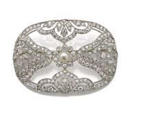 A belle époque cultured pearl and diamond brooch, Dreicer & Co.,