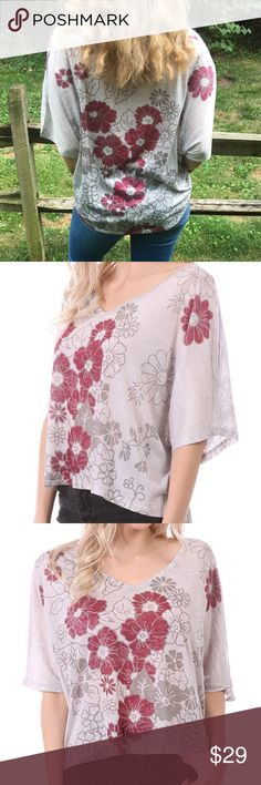 ❗️SALE❗️Floral Hi Low Top Floral Cream hi low top featuring a V neckline and wide sleeves. Made of polyester/ rayon blend. Marled. Pair it with jeans, leggings, pants or a skirt. MADE IN USA Bchic Tops