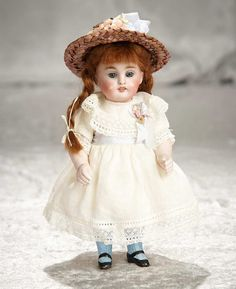 "7"" German all-bisque miniature doll with sleep eyes and blue stockings. $400/500"