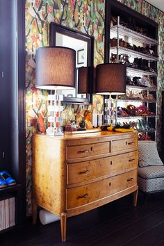 Midcentury, eclectic dresser and shoe shelves in bedroom