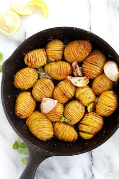 Garlic Butter Hasselback Potatoes - easy roasted potatoes with garlic and butter. Each potato is cut and sliced to form the Hasselback shape   rasamalaysia.com
