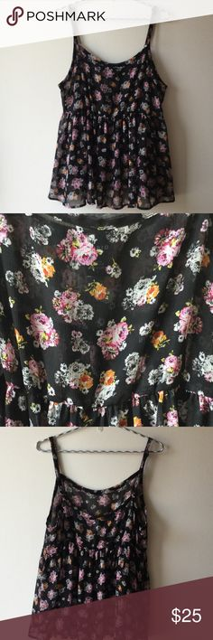 Today only! Torrid flowy flower tank Super sweet top by Torrid. Is size 1 on Torrid size chart which converts to a size 14/16.  Great flower detail with adjustable straps. Will need to wear camisole or tank under as it is sheer. torrid Tops Tank Tops