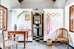 Guest quarters with black-and-white tiled bath at Sunshine Stories, a surf and yoga retreat in Sri Lanka. Mitchell Fong photo via Indoek.