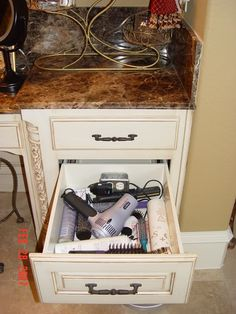 Photo awful, but GREAT idea: an outlet inside a drawer in the bathroom for your appliances. How ingenious is that?