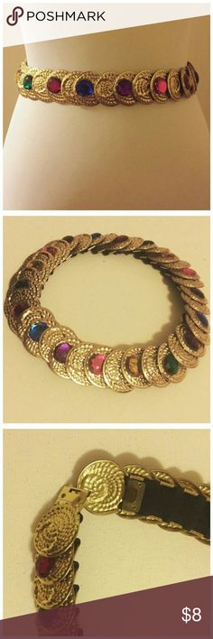 "Vintage Gold Jeweled Medallion Metal Stretch Belt Vintage Gold Medallion Metal Stretch Belt --- 27"" unstretched --- over 40"" stretched --- interior hook secures belt --- excellent vintage condition, no signs of wear. Accessories Belts"