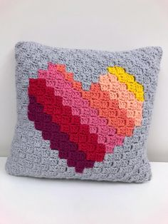 Crochet Blankets Design The Love Heart cushion is a simple but striking design, made using Paintbox Simply Aran it makes a perfect piece of home decor! Find this pattern and more crochet inspiration at LoveCrochet. C2c Crochet Blanket, Crochet Pillow Pattern, Crochet For Beginners Blanket, Crochet Stitches Patterns, Crochet Motif, Crochet Blankets, Free Crochet, Crochet Home, Crochet Crafts