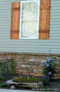 Wood Board And Batten Stained Shutters With Metal Bolts.