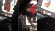 A fight ensues as a fast-food worker is yanked by her hair from a drive-thru window into a car.