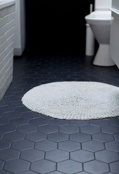 This from Emma Jane Nation pairs shiny white wall tile with matte black floor tile, adding a modern twist to an otherwise very traditional bathroom. Grey Bathroom Floor, Dark Gray Bathroom, Basement Bathroom, Shower Floor, Black Kitchen Floor Tiles, Hexagon Tile Bathroom Floor, Modern Bathroom Tile, Kitchen Black, Industrial Bathroom