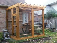 wooden cat enclosure with real tree cat tower…..maureen this would be wonderful for daniel and anthony